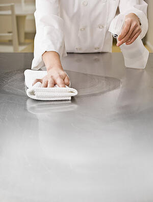 Chef Spraying cleaner
